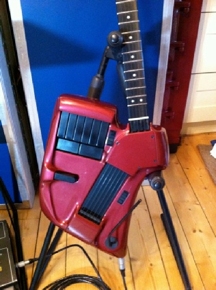 "Alec's SynthAxe controller - in ""Porsche wine red"""